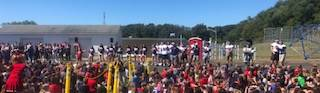 Football Team at Pep Assembly