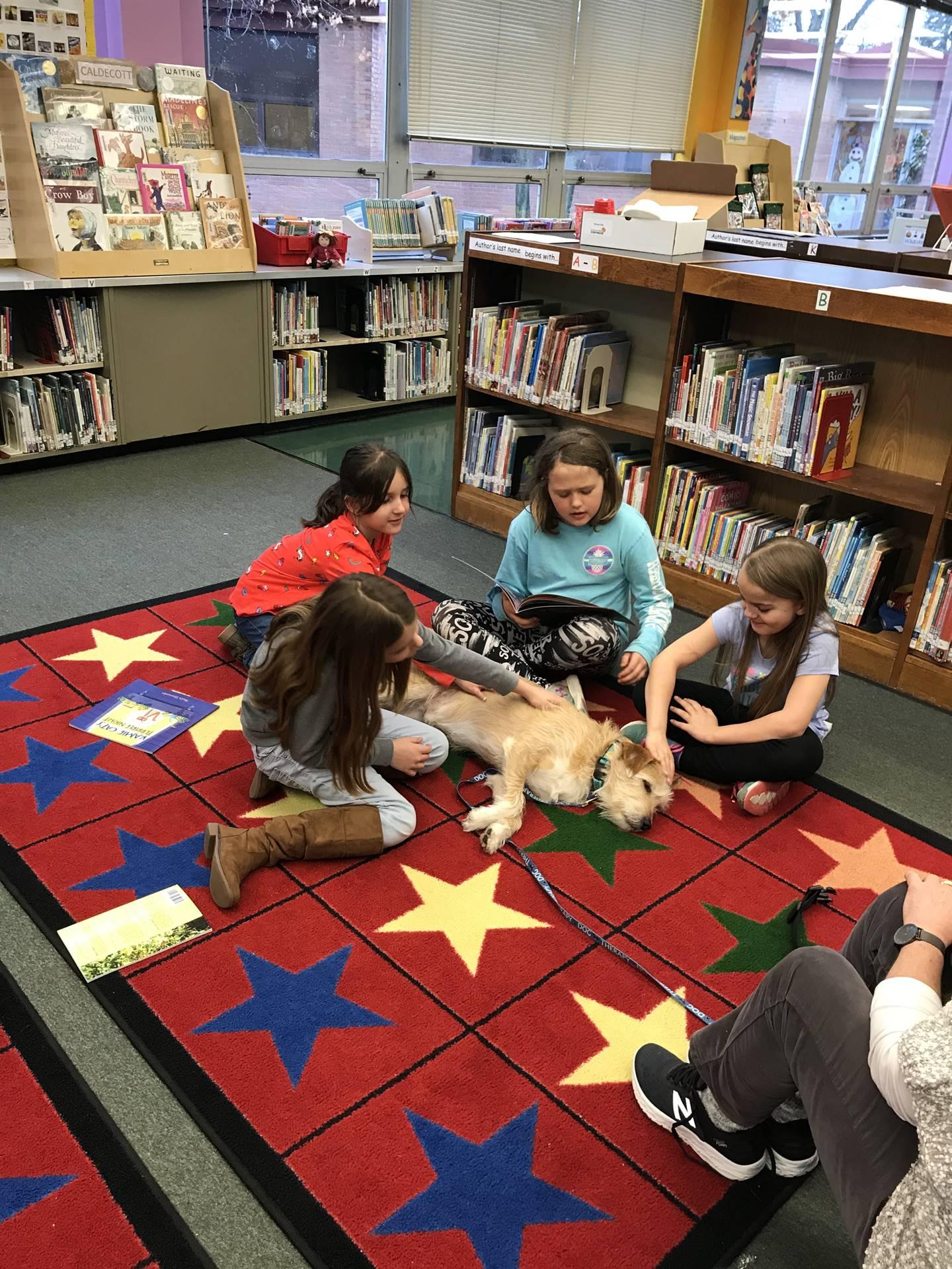 Mrs. Schnur's-Reading-Club-reads-to-Jamison