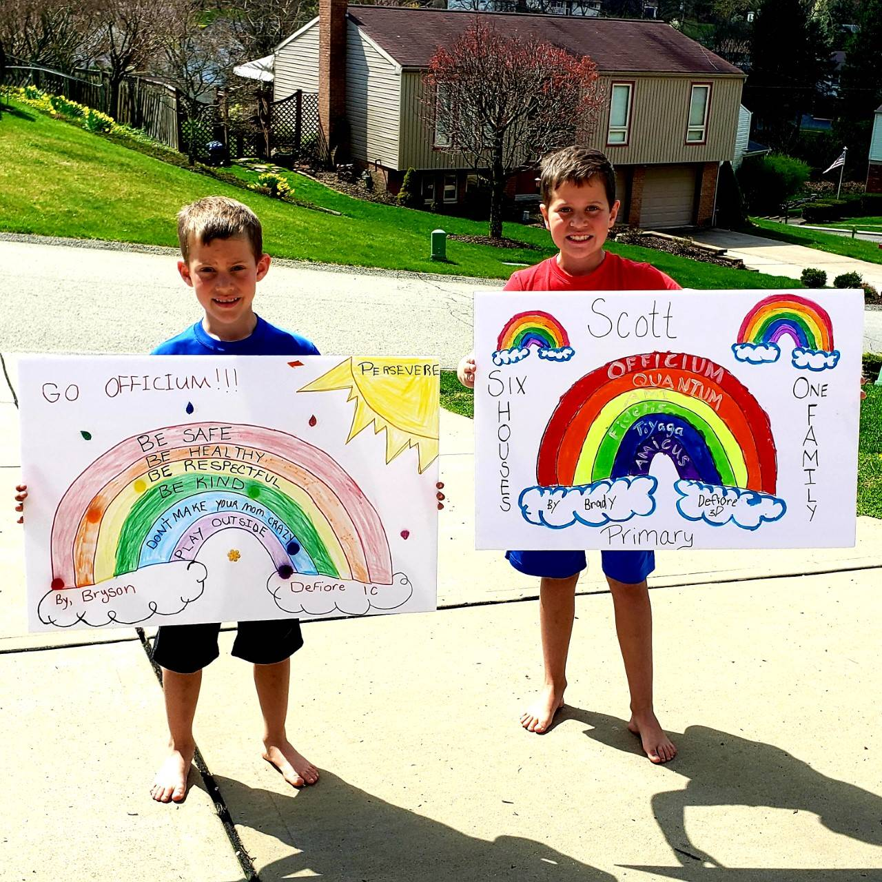 Boys with rainbow posters