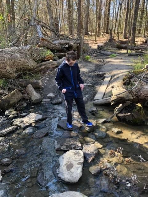 boy walking in creek