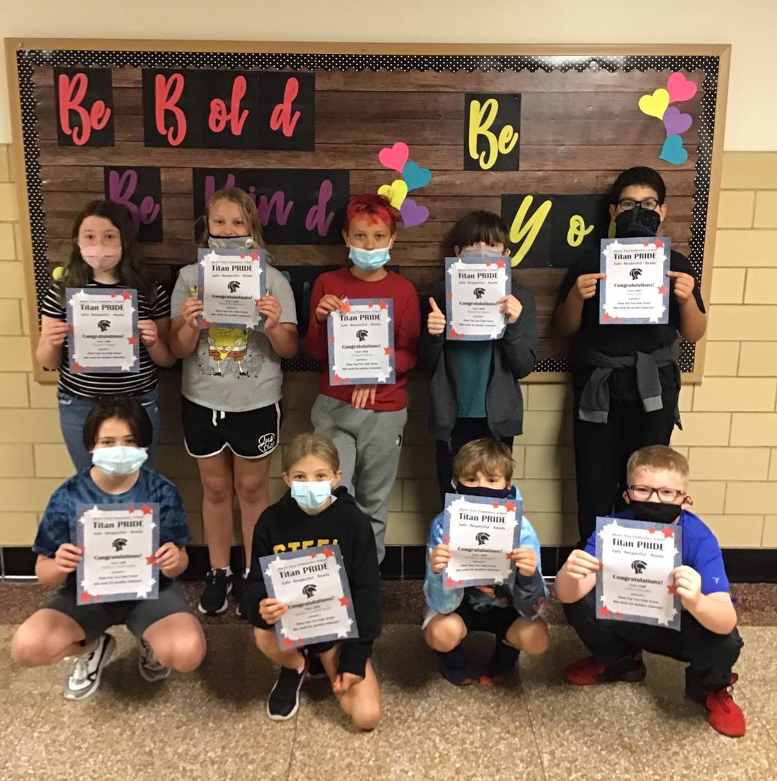 9 students with Titan Top 10 Certificates