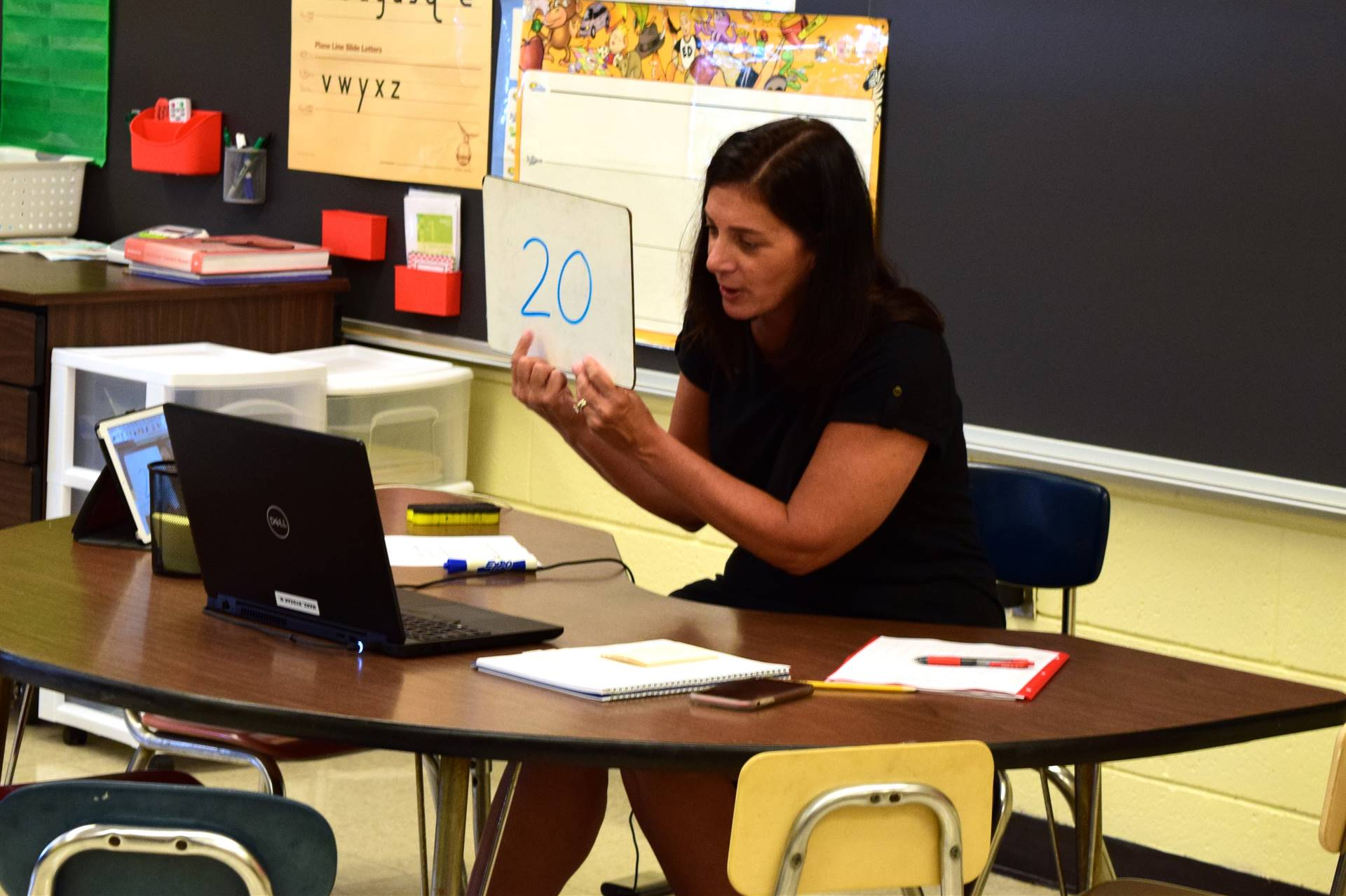 First grade teacher using her laptop to teach virtually