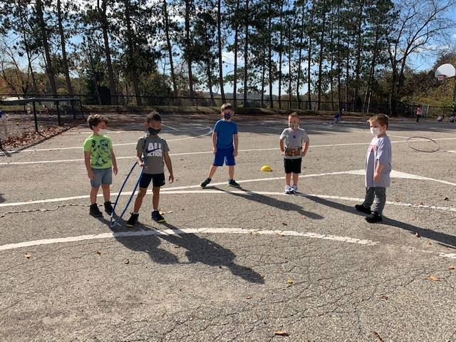 kindergarten students outside during recess