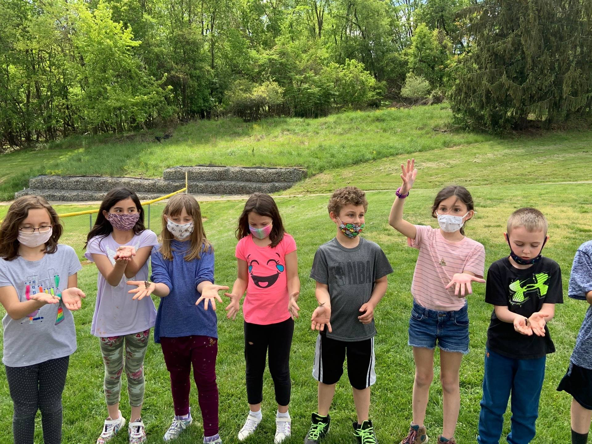 Mrs. Vita and 2A having a butterfly release celebration