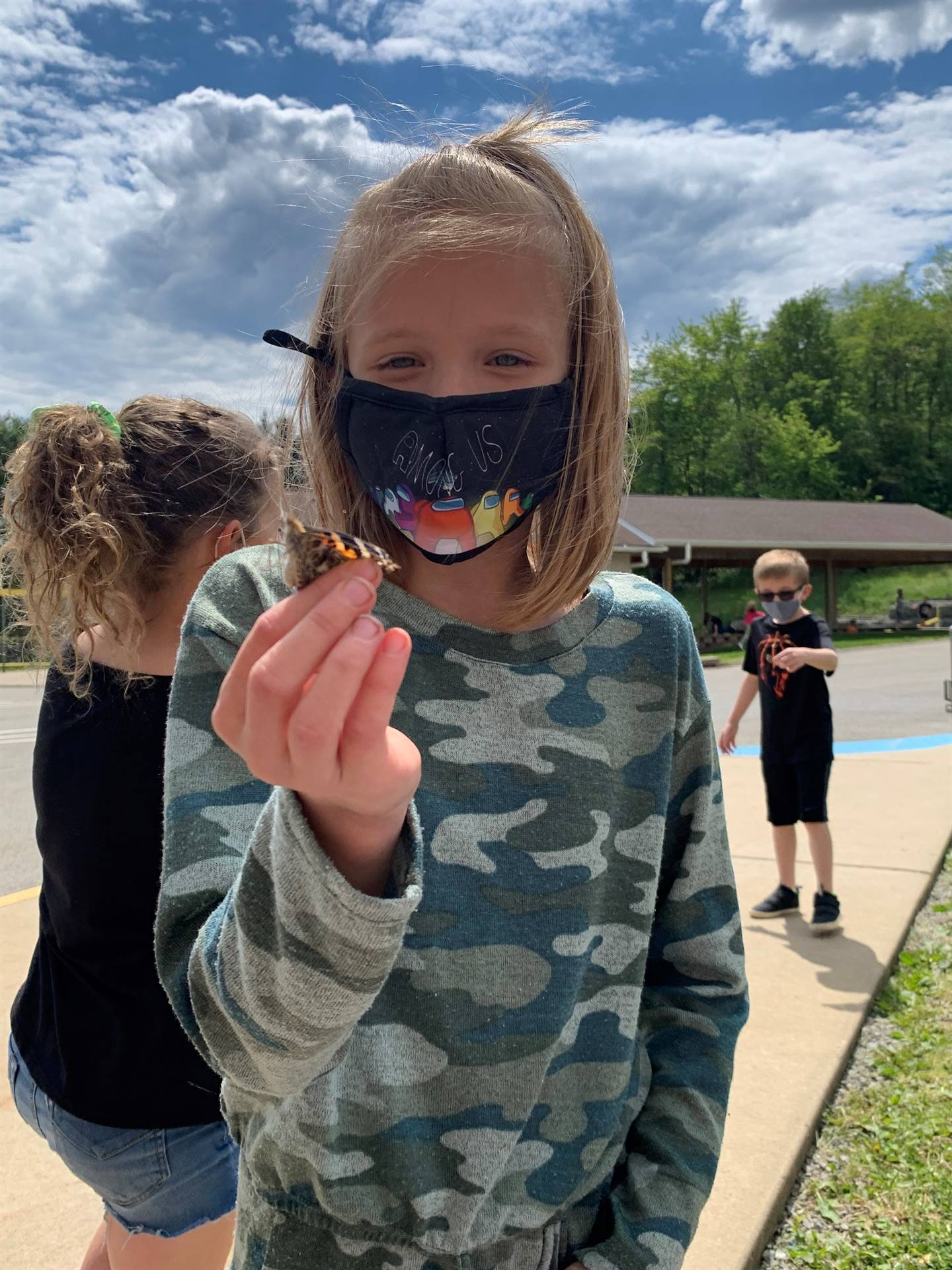 Mrs. Beck and 2D release the butterflies