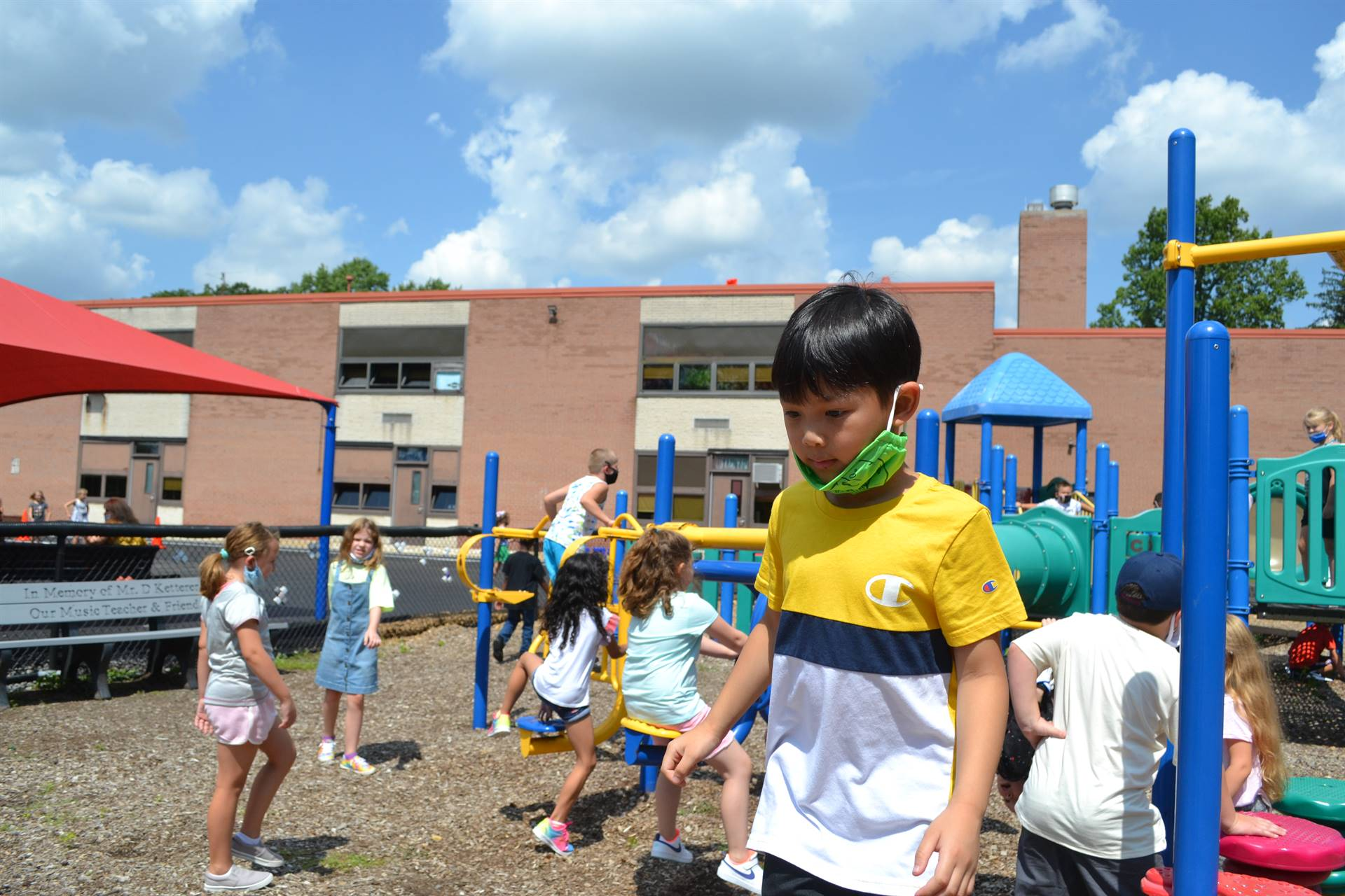 Students playing on the playground equipment