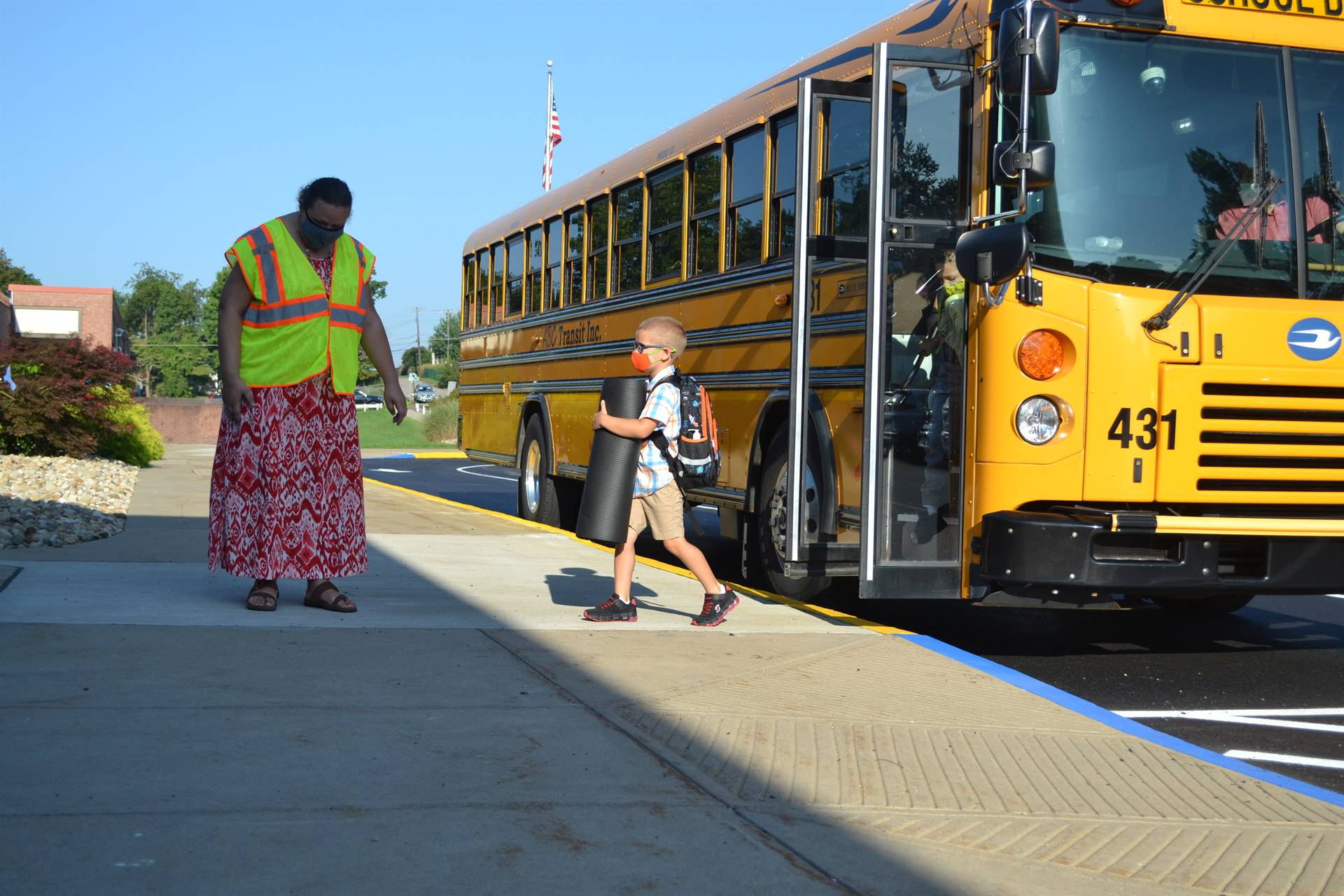 students arriving on the bus, first day of school