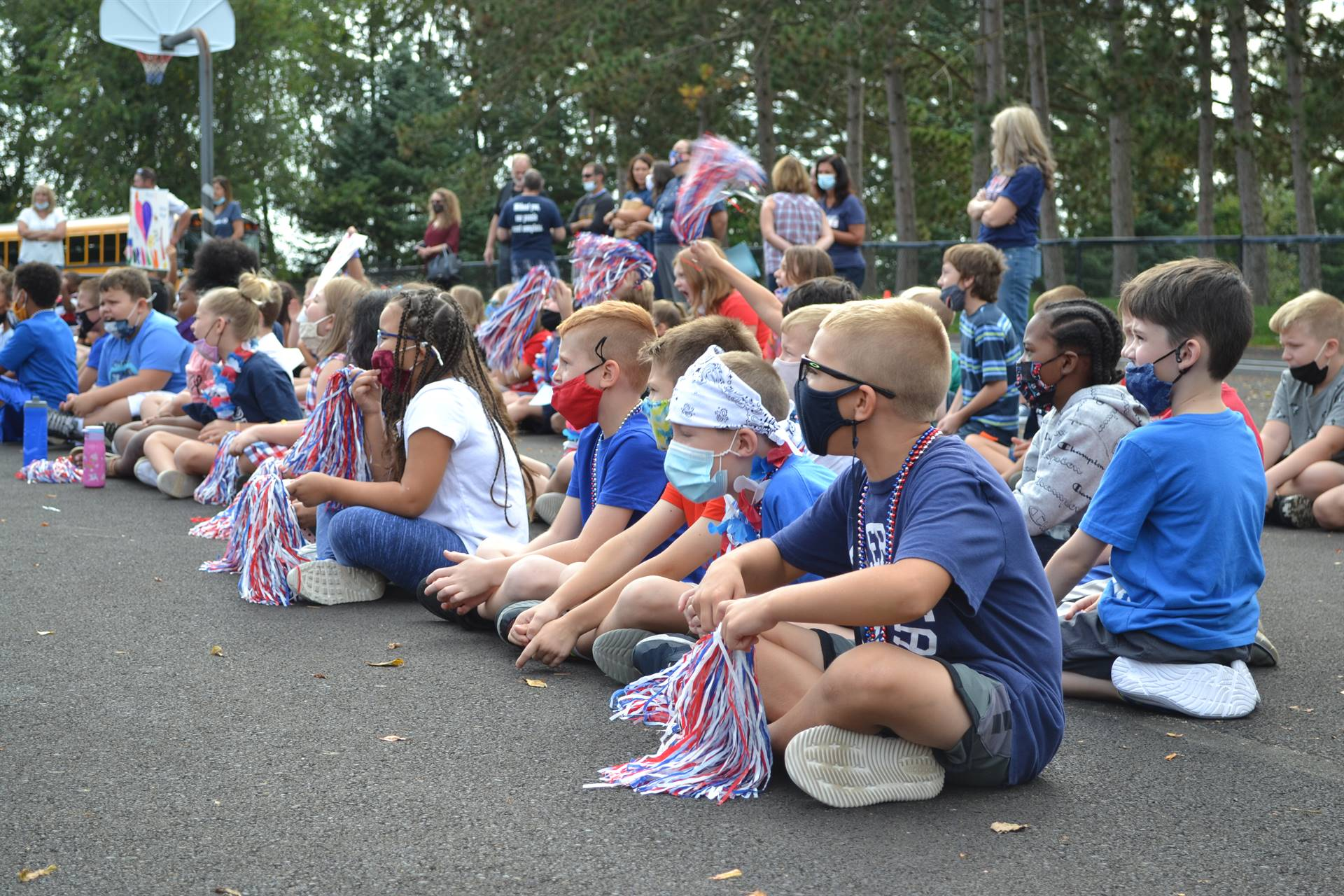students watching the marching band playing during pep rally