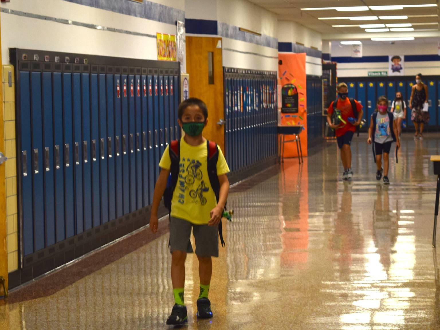 Students walking down 4th grade hallway