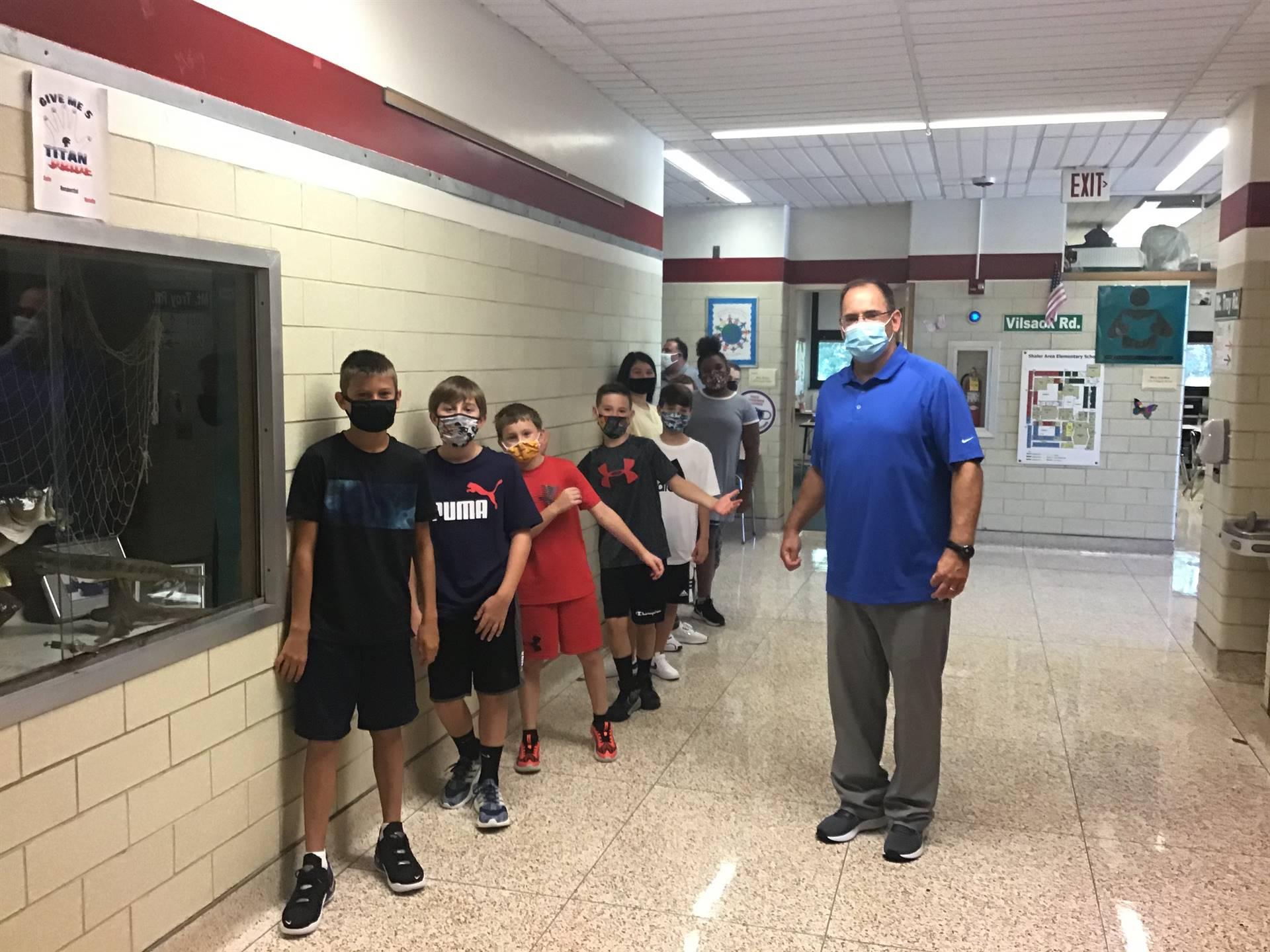 6th graders walking down the hallway