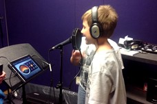 Boy standing in front of microphone