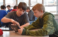 Two boys looking at an iPad